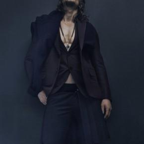 Businessman like Rock Star! Better suit, better body.